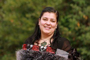 Woman wearing korowai (traditional cloak).